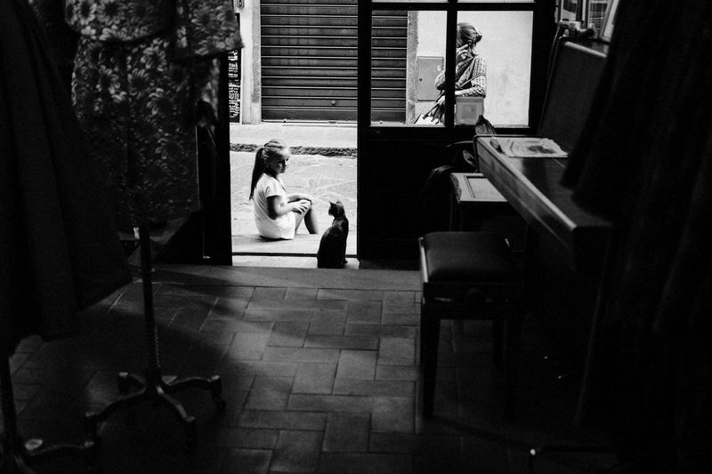 Childhood Girl Candid Black And White Street Photography Streetphotography Blackandwhite Shadows & Lights Black & White Sweet Cat Real People Indoors  Women Lifestyles Sitting Seat Leisure Activity My Best Photo