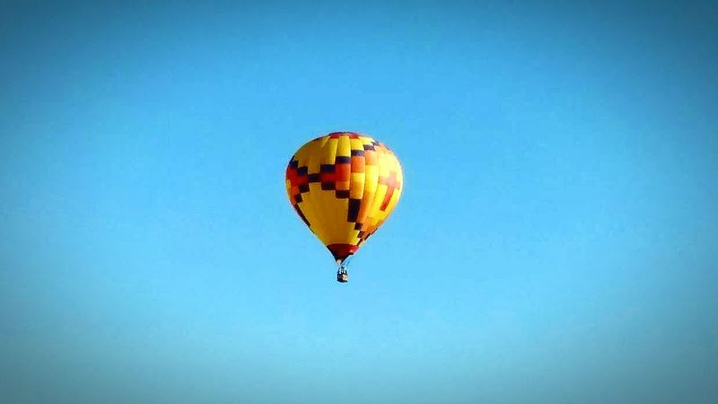 Hot Air Balloon Flying Mid-air Blue Clear Sky Transportation Outdoors Horizontal No People Day Sky Ballooning Festival Nature Sports Activity Parachute