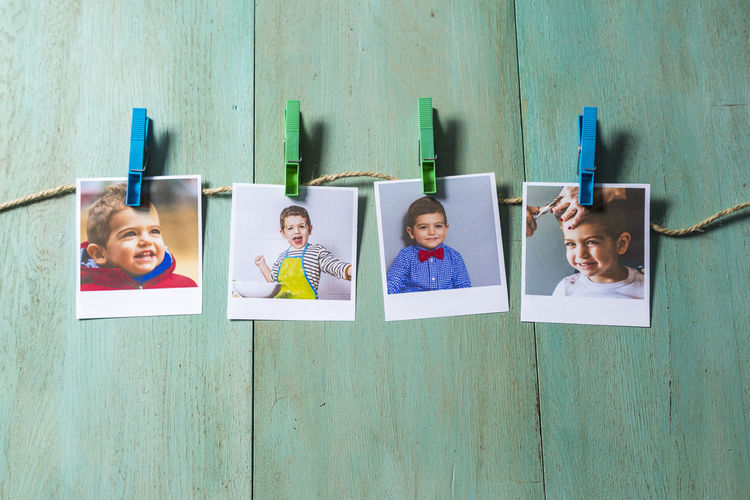 High angle view of photographs on wooden table