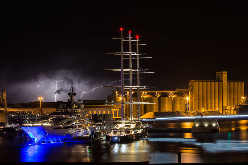 Night Illuminated Nautical Vessel Water Transportation Sky Architecture Building Exterior Mode Of Transportation Built Structure No People Reflection Waterfront Moored Sea Nature Harbor Motion Ship Outdoors Sailboat Bolt Thunderstorm Thunder Yatch