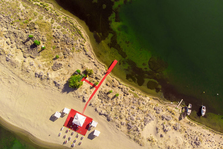 Aeiral view of red pier on the beach. High Angle View Day Transportation Nature Outdoors Water Scenics - Nature Mode Of Transportation Land Car No People Landscape Beach Beauty In Nature Mountain Non-urban Scene Motor Vehicle Environment Road Pier Red Sand Aerial View Top View Dronephotography