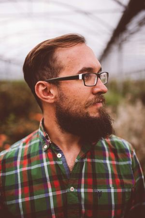 bearded man with glasses Hairstyles Hipster Style Lifestyle Beard Beard Style Bearded Bearded Man Beardman Boho Casual Clothing Checked Pattern Eyeglasses  Facial Hair Glasses Hairstyle Headshot Hipster Lifestyles Lumber Jack Man Style Portrait Stylish Guy Stylish Hairstyle.  Stylish Man Young Men