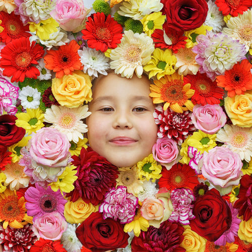 Portrait of girl with pink flower bouquet