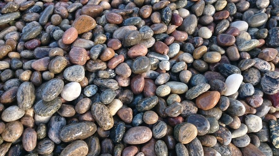 Full Frame Abundance Backgrounds Large Group Of Objects Pebble Stone - Object Day Nature Outdoors Multi Colored Many Shore No People Extreme Close Up Beauty In Nature Heap