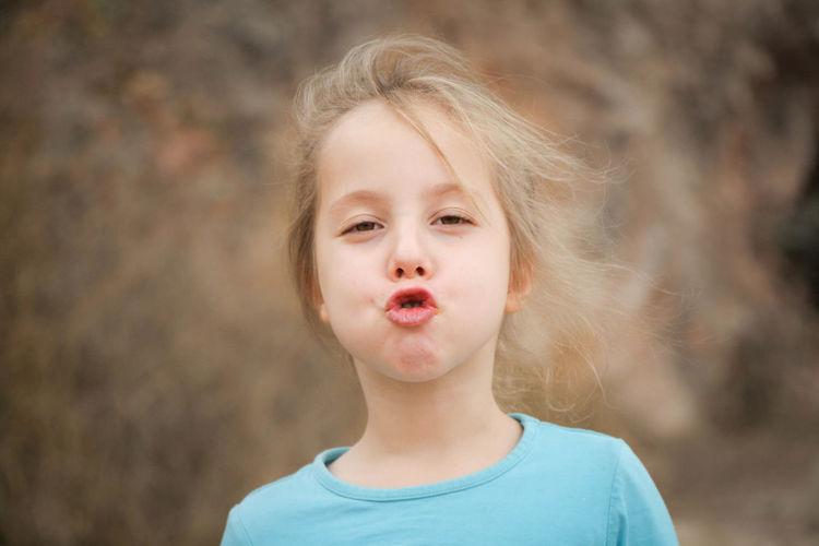 Portrait of cute girl puckering lips