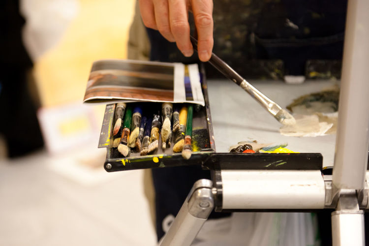 Paint Brush Art And Craft Business Choice Close-up Finger Focus On Foreground Hand Human Hand Indoors  Occupation One Person Painting Art Selective Focus Table Variation