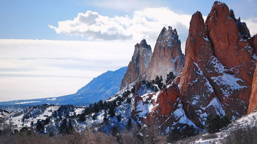 Garden of the Gods and Cheyenne Mountain Beauty In Nature Cloud - Sky Cold Temperature Day Environment Formation Landscape Mountain Mountain Peak Mountain Range Nature No People Non-urban Scene Panoramic Scenics - Nature Sky Snow Snowcapped Mountain Tranquil Scene Tranquility Winter
