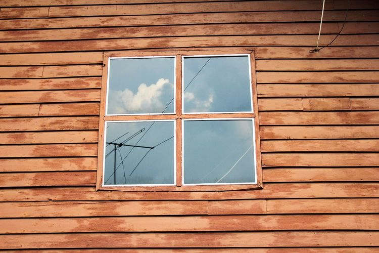 Low angle view of window on house wall