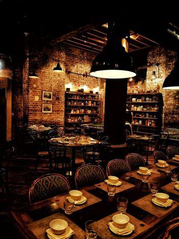 dinner Restaurant Eating Dining Brick Warm Cosy Ambience Illuminated Diner Wineglass
