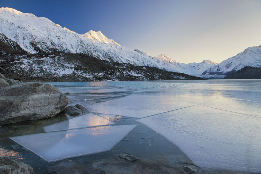 The beautiful Tasman Lake in Aoraki/Mt Cook National Park in New Zealand. The first rays of light can be seen hitting the mountain at sunrise with large ice sheets frozen in the glacial river. Alpine Aoraki Mount Cook National Park National Park Nature Nature Photography New Zealand Scenery New Zealand Landscape New Zealand Photography Reflection Alps Blue Glacial Glacier Lake Mountain Mountain Range New Zealand Scenics Snow Snowcapped Mountain Sunrise Sunrise_sunsets_aroundworld Tasman Lake Tourism