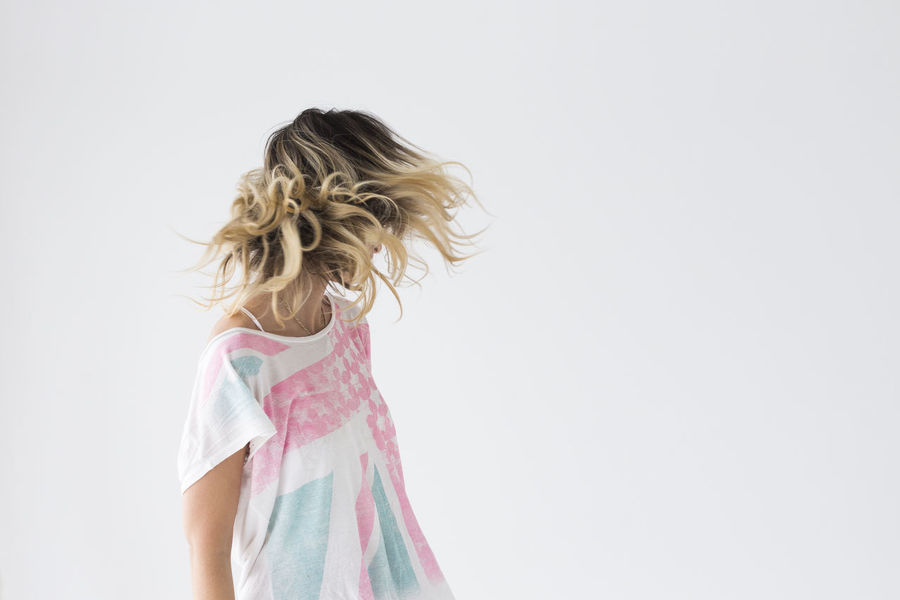 Adult Blonde Hair Child Day Hair Matte Motion One Girl Only One Person People Shake Studio Shot Tourism Urban Urban Geometry Waist Up White Background Woman