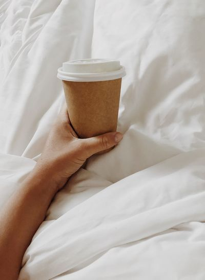 Morning coffee Neutral Colors Earth Tones Coffee Morning Coffee Morning Rituals Coffee In Bed On Bed Take Away Coffee Take Away Cup Textile Bed Furniture Drink Indoors  Human Body Part Food And Drink Bedroom Sheet Linen Human Hand Blanket Domestic Room Relaxation Cup
