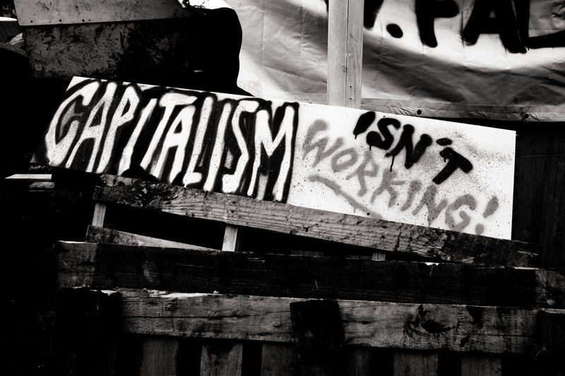 Text Communication Wood - Material No People Sign Information Close-up Graffiti Outdoors Message Graffiti Capitalism Anti Capitalist Anti Capitalism Socialism Black And White Street Sign Protest