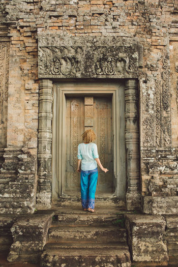 Siem Reap Cambodia Angkor Curly Hair Girl Architecture One Person Built Structure Rear View Building Building Exterior Standing Full Length History Adult Casual Clothing The Past Staircase Day Real People Young Adult Women Old Entrance Hairstyle Outdoors Architectural Column Stone Wall