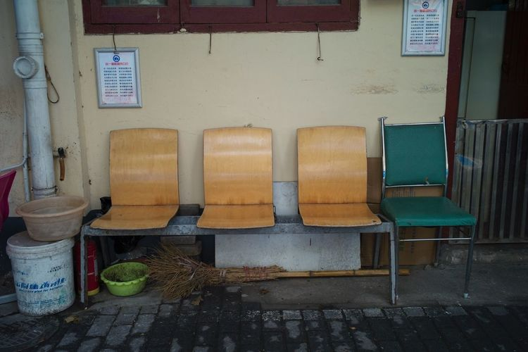 Empty chairs against building