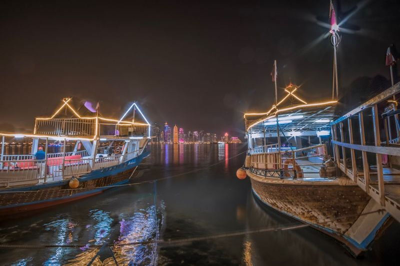 Dhow Boat in Corniche Dhowcruise Qatar Doha Illuminated Night Water Transportation Architecture Nautical Vessel Reflection Sea Building Exterior City Outdoors No People Nature Mode Of Transportation Travel Destinations Sky Built Structure Lighting Equipment Light Motion