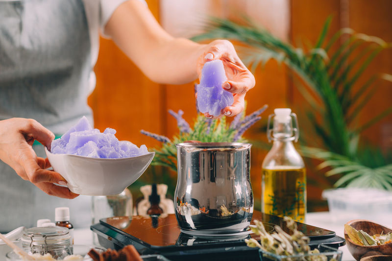 Woman preparing homemade soap