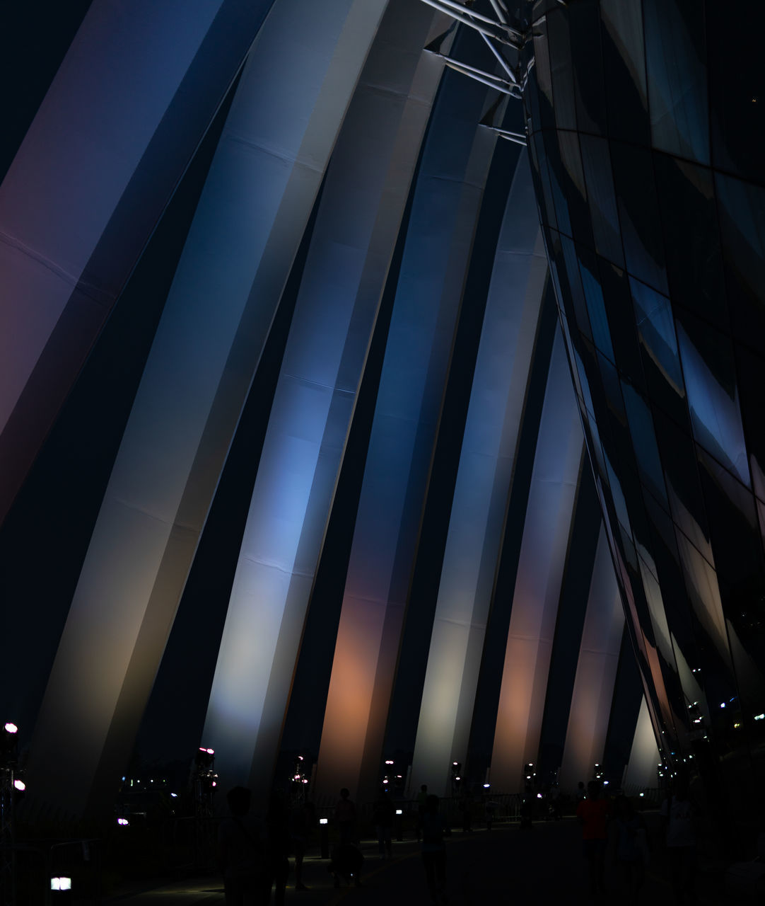 architecture, built structure, low angle view, building exterior, sky, no people, illuminated, glass - material, city, modern, pattern, nature, night, dusk, outdoors, side by side, building, silhouette, window, transportation