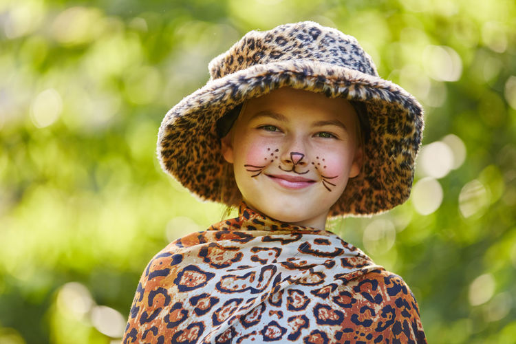 Close-up portrait of girl wearing leopard print costume