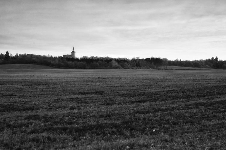 Bregninge Church, towering over the barren fields in the winter. Vindeby, Denmark. Barren Landscape Beauty In Nature Black And White Bregninge Kirke Church Field Field Landscape Nature No People Silhuette