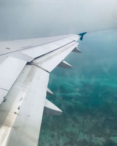 Travel Airplane Air Vehicle Aircraft Wing Transportation Mode Of Transportation Flying Travel Water Motion Scenics - Nature Cloud - Sky Environment Nature Beauty In Nature Mid-air Outdoors No People Sky Day Journey