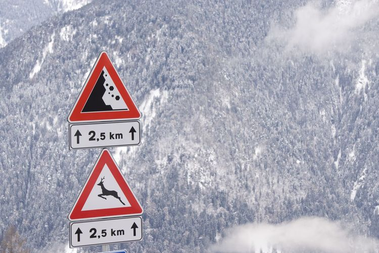 Information sign against mountain during winter