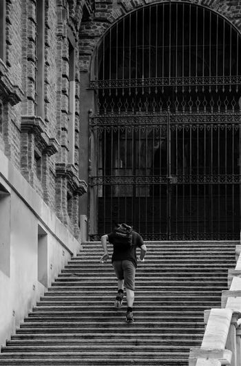 Low Angle View Of Man Climbing Steps