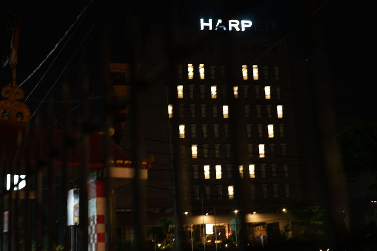 Low angle view of illuminated building at night