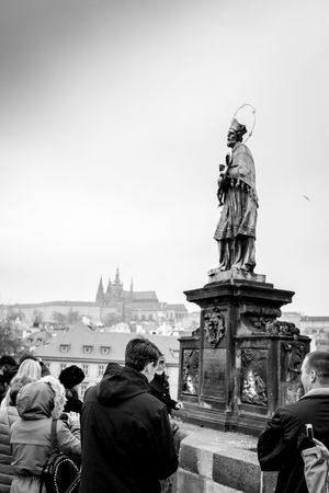 devotion Blackandwhite Charles Bridge Karlův Most St. Vitus Cathedral Statue Streetphoto_bw Streetphotography Travel Photography