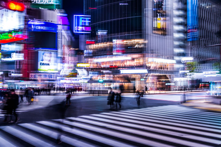 Blur Motion Technology Tech Speed Neon Futuristic Development Business Finance And Industry Business Algorithm Analytics Revolution Transformation Acceleration Business Acceleration Tokyo Japan Shibuyascapes Shibuya People Silhouette Abstract Street City Architecture Crosswalk City Life Zebra Crossing Blurred Motion Transportation Crossing Illuminated Night Building Exterior Road Marking Sign Road Crowd Travel Destinations Walking Built Structure City Street Outdoors Office Building Exterior Humanity Meets Technology My Best Photo