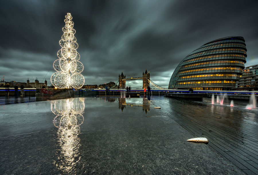 Xmas Christmas London United Kingdom England Center City Metropolis Capital Cities  Famous Place Europe No People Copy Space christmas tree Cold Dark Christmas Lights Tower Bridge  Monument City Hall Greater London Southwark  Dramatic Sky December Architecture Built Structure Building Exterior Night Illuminated Water Sky Cloud - Sky Travel Destinations Nature Transportation Connection Long Exposure Building Bridge Blurred Motion Reflection Bridge - Man Made Structure Office Building Exterior Outdoors Skyscraper Modern