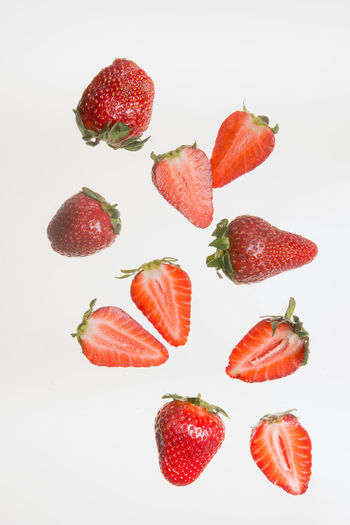 High angle view of strawberries on white background
