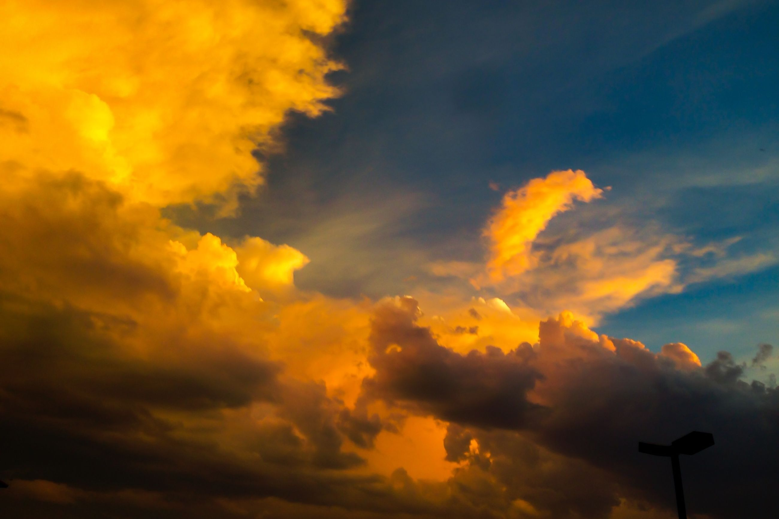 sunset, sky, low angle view, cloud - sky, beauty in nature, orange color, scenics, cloudy, dramatic sky, tranquility, cloudscape, nature, tranquil scene, cloud, sky only, idyllic, silhouette, weather, majestic, moody sky