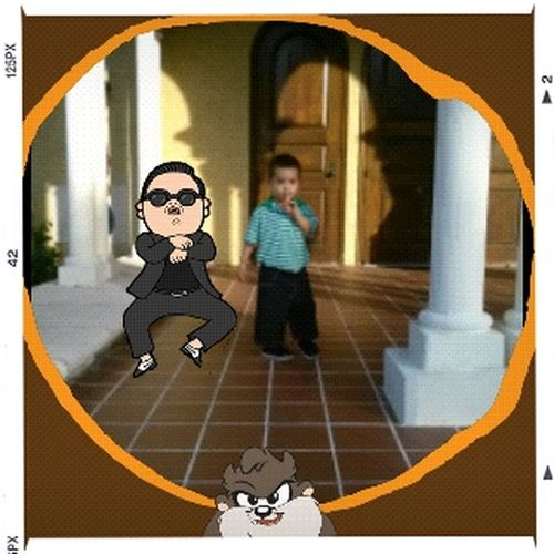 my nephew jayden next to psy he lives this song gangmenstyle.
