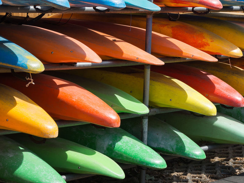 Kayaks in the Sunshine Colours Holiday Boat Boats Choice Close-up Day Drying High Angle View Kayak Large Group Of Objects Multi Colored Nature No People Outdoors Pattern Rack Relaxation Repitition Summer Sunlight Variation