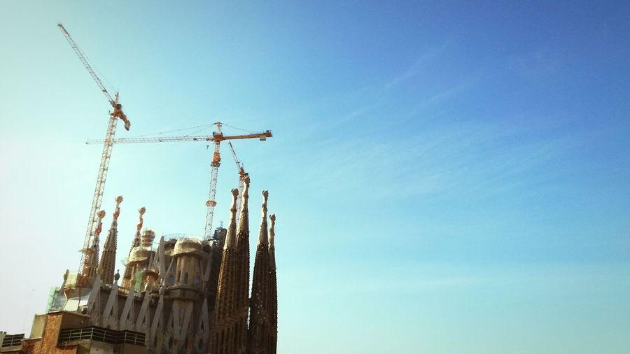 Crane - Construction Machinery Day Sky Blue No People Architecture Historical Buildings Sagrada Familia Cathedral Sagrada Familia Construction Travel Destinations BCN Barcelona Catalunya Art Is Everywhere