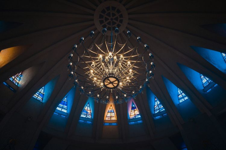 Low angle view of illuminated ceiling in church