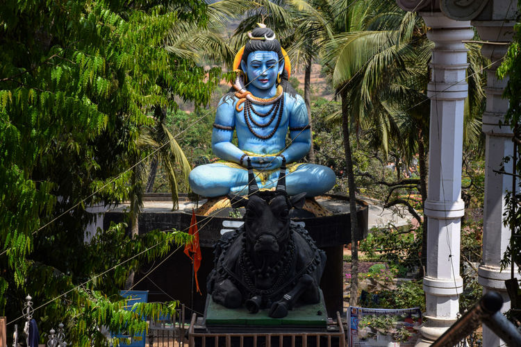 Statue of buddha against plants