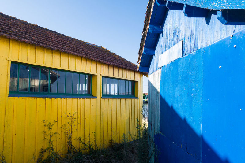 Farm Village Wall - Building Feature Wood - Material Wooden Old Traditional Fishery Farming Fishermanvillage Colored Blue Yellow Corrugated Iron Window Sky Architecture Building Exterior Built Structure Weathered Worn Out Residential Structure Closed Latch Shutter Civilization Rusty Exterior Peeled Peeling Off Door