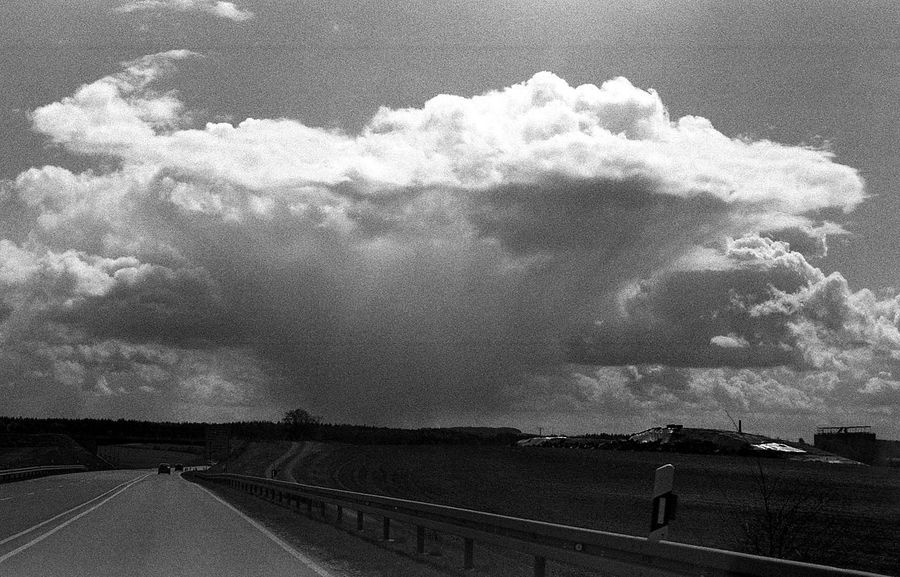 It rains somewhere. 35mm Film AgfaPhoto APX 400 (new) Beauty In Nature Black And White Cloud - Sky Exakta 3.5-4.5/35-70mm Film Photography Landscape Rain Road Sky TCPM The Way Forward