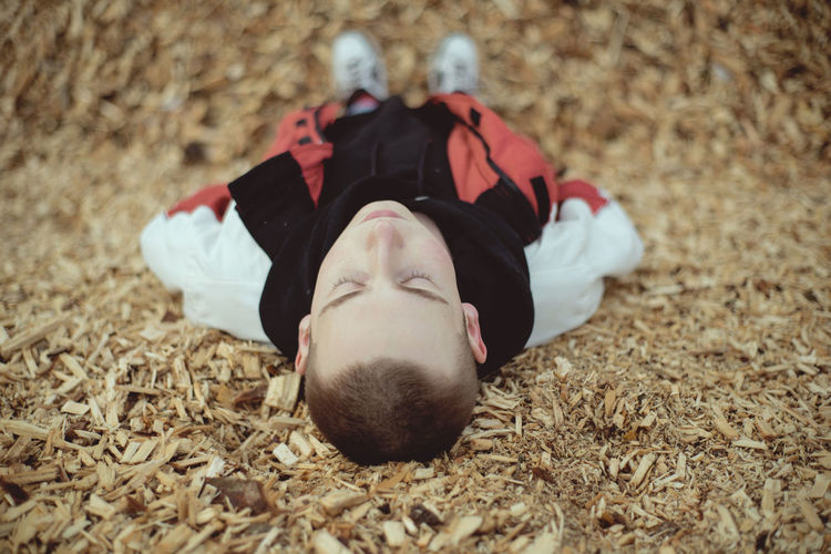 Teenager Teen Teenage Boys Portrait Boy Young Youth Streetstyle Street One Person Real People Lying Down Relaxation Resting Sleeping Close-up Warm Clothing Childhood