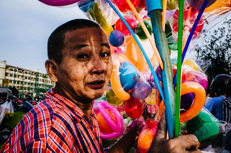 Close-up portrait of multi colored balloons