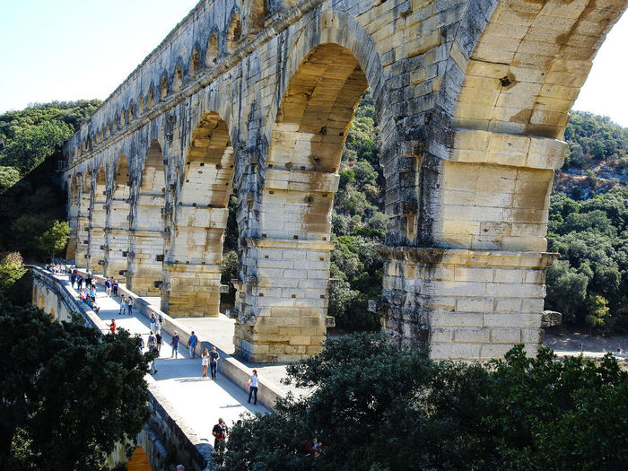 Pont-Du-Gard Ancient Ancient Civilization Arch Architecture Built Structure Day History Nature No People Old Ruin Outdoors Sky Travel Destinations Tree