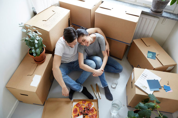 High angle view of people sitting in box