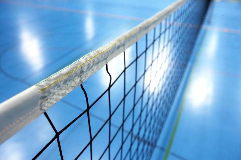 Close-up of net against blue sky