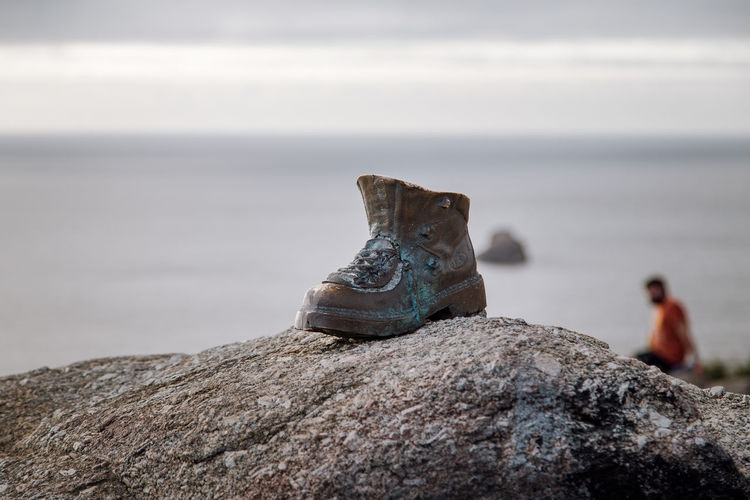 Once, the end of the world for Roman Empire Finistere Galicia SPAIN Santiago Rout Boot Close-up Day Focus On Foreground Outdoors Rock Rock - Object Sculpture Sea Selective Focus Sky Solid Tranquil Scene Tranquility Water A New Perspective On Life