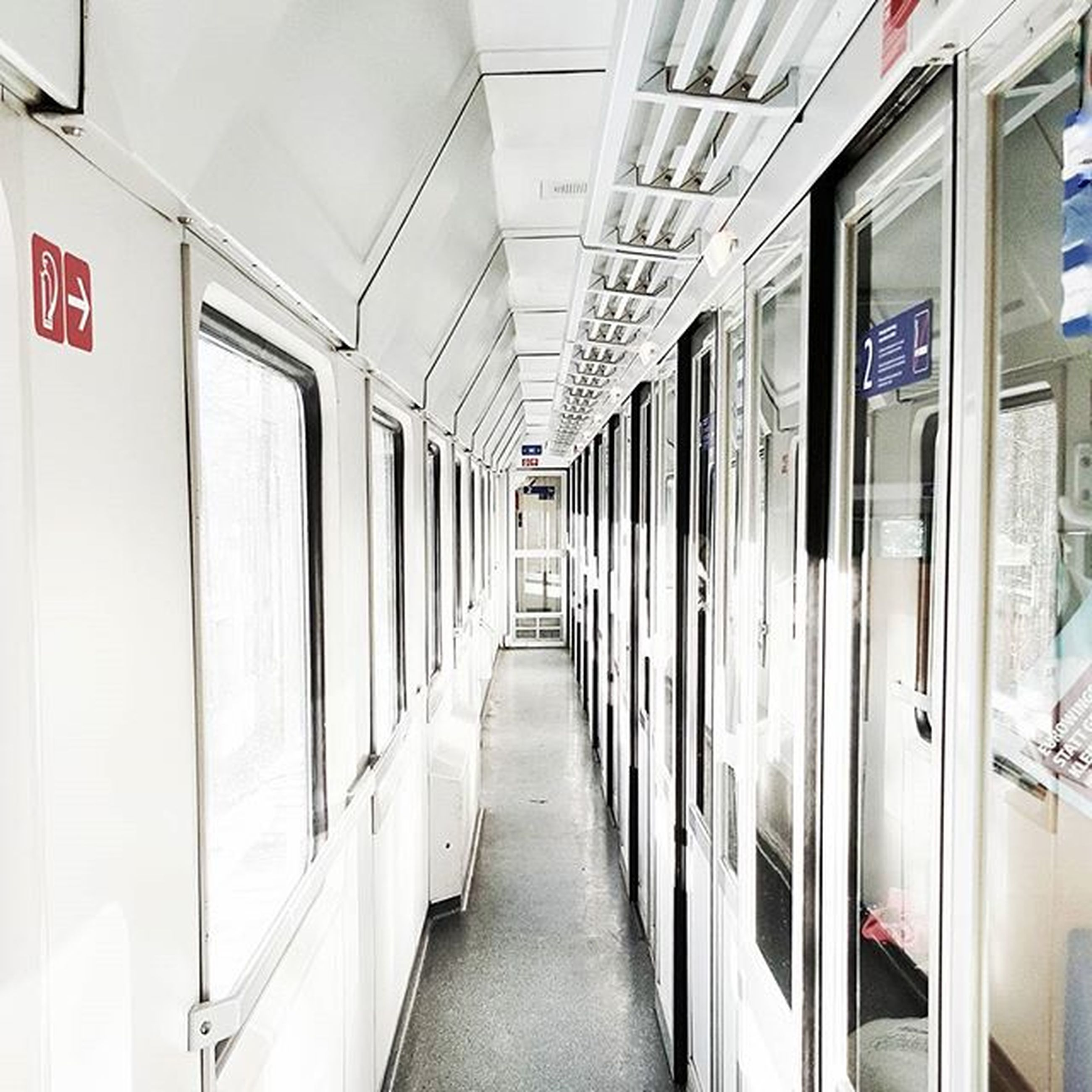 indoors, the way forward, transportation, architecture, built structure, empty, diminishing perspective, narrow, corridor, ceiling, public transportation, vanishing point, absence, rail transportation, long, in a row, railroad station platform, subway, railroad station, illuminated
