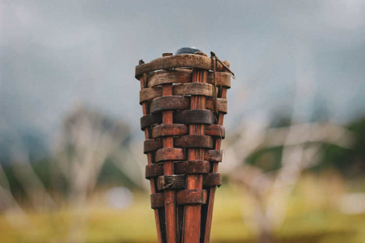 Torch lamp made of woven bamboo