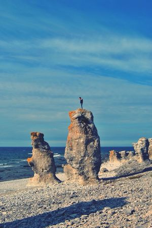 A man standing on a rock looking at the ocean Rocks Ocean Sea And Sky Man Alone Scenery Sweden Landscape Beach Loneliness Beauty In Nature Nature_collection Nature Photography Beachphotography Beachlife Langhammars Gotland Fårø Scenics Scenic Rock Stone Landscapes With WhiteWall