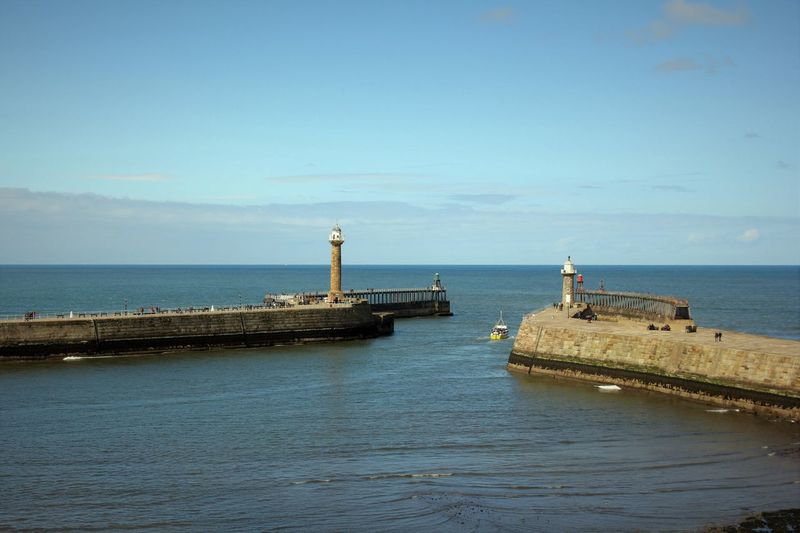 Heading out to sea Blue Day Horizon Over Water Lighthouse Little Boat Outdoors Scenics Sea Sky Travel Destinations Water Whitby